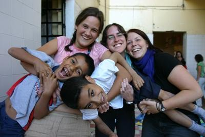 Volunteers enjoying play time with children at a daycare on a Care project in Mexico