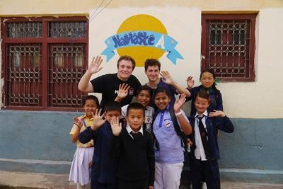 Projects Abroad Teaching volunteers with a group of children at a vacation camp in Kathmandu, Nepal.