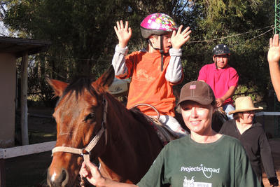 Volunteer with animals such as horses to treat children with special needs