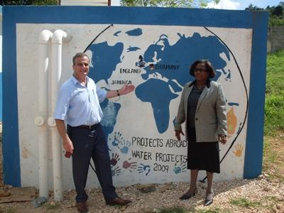 Founder Dr.Peter Slowe visiting a school principal at a Teaching project in Jamaica