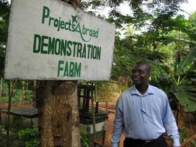 Staff member in Ghana shows off the demonstration farm created by volunteers on the Farming & Agriculture project