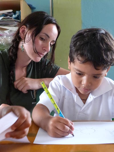 title: Progress of a child's writing skills is monitored by a volunteer for our Global Impact Database
