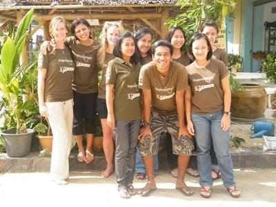 Staff members pose for a photo outside of the Projects Abroad office in Thailand, Southeast Asia.