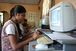 Locals use computers on an IT project in Sri Lanka