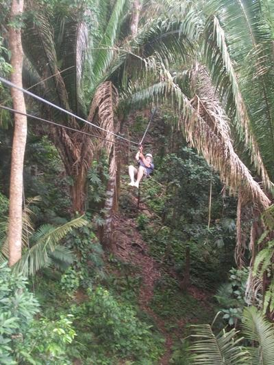A Projects Abroad volunteers enjoys leisure time in Belize and goes ziplining in a forest.