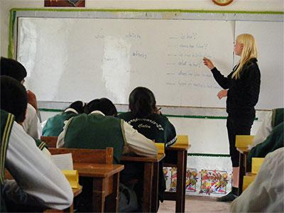 Projects Abroad volunteer teaching students in her classroom, Sacred Valley, Peru