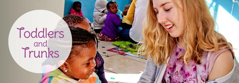 Projects Abroad volunteer does an educational activity with a child at a care project in Cape Town, South Africa
