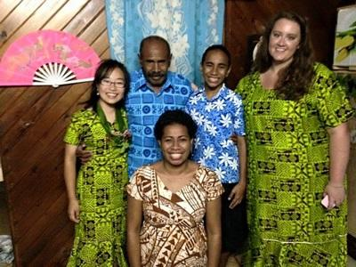 A local host family and two Projects Abroad volunteers in Fiji, South Pacific.
