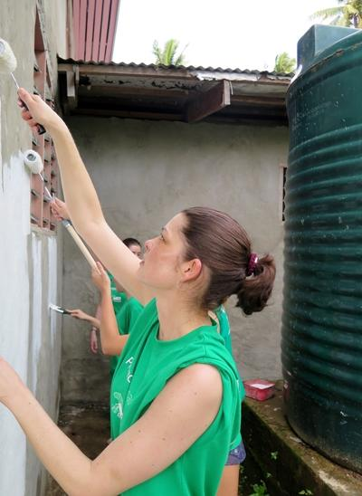 A village building gets a fresh coat of paint from Projects Abroad Fiji volunteers.