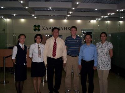 Male volunteer with local staff on a Business internship in Asia