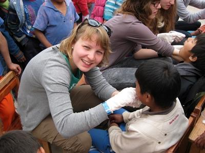 A child gets his teeth checked at a medical outreach in South America