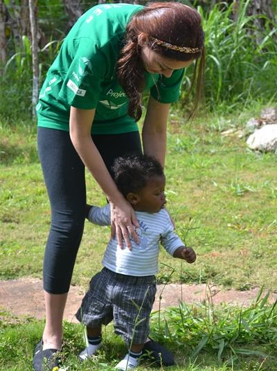 A Jamaican child spends time with a Projects Abroad volunteer.