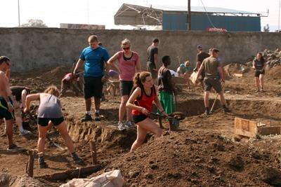 Volunteers hard at work on a building site in Kenya