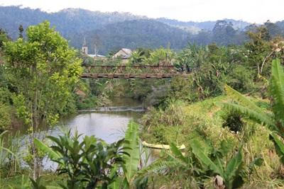 A view of a hanging wooden bridge to cross the river in Madagascar
