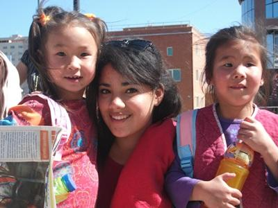 Volunteer meets local children in Mongolia, Asia