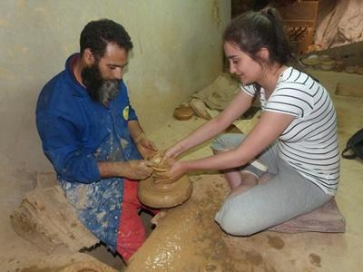 A Projects Abroad Morocco volunteers learns about local pottery in a class.