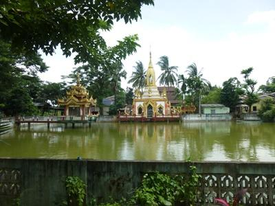 A traditional temple located beside a lake in Myanmar, Asia.
