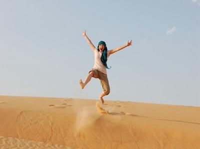 Volunteer jumps in the middle of the desert while traveling in Senegal