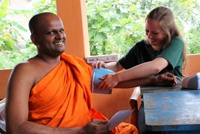 A Sri Lankan monk has a health check at a Projects Abroad medical outreach.