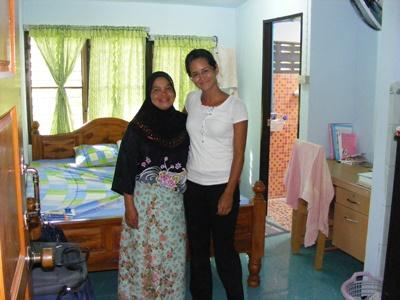 Volunteer and host mom stand inside the house