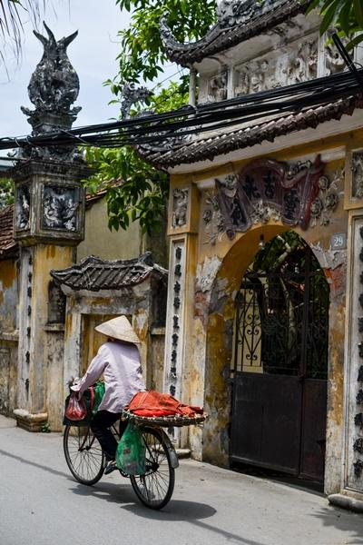 A Vietnamese woman rides a bike in Vietnam's capital city, Hanoi, where Projects Abroad Vietnam is based.