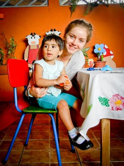 Volunteer with a child in a classroom on the Teaching project in Central America with Projects Abroad