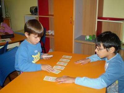 Children play card games at a Projects Abroad project placement in Europe