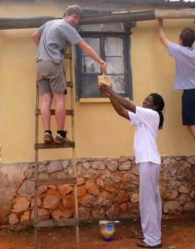 Volunteering painting the exterior of a building on the Building project in Jamaica with Projects Abroad