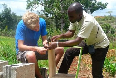 Volunteers working together to construct a frame on the Building project in Jamaica