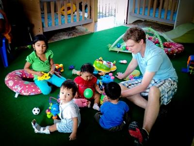 Volunteer doing childcare playing with toy blocks on the Care project in Ecuador, Latin America