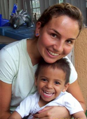 Volunteer works with a baby at a care center in South America with Projects Abroad