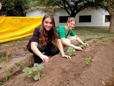 Volunteers planting seeds in a community farm on the Farming project in South America