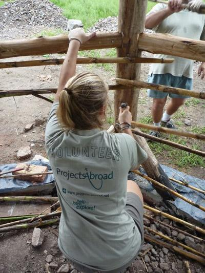 Projcts Abroad Volunteer working hard on a Building Project during her Gap Year Abroad
