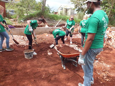 Projects Abroad volunteers help build a playground during their last-minute trip to Jamaica