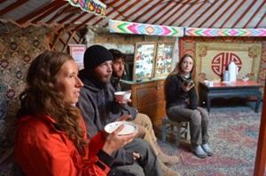Volunteers drink tea with Mongolian Nomads during a Volunteer Travel trip