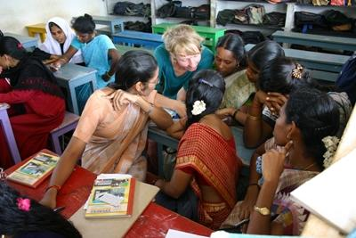 Volunteer reading to students on a Teaching Project Overseas