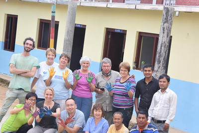 A group of senior volunteers abroad with other volunteers and staff in Nepal
