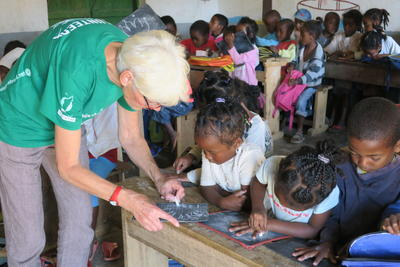 A senior volunteer abroad works with children in Madagascar