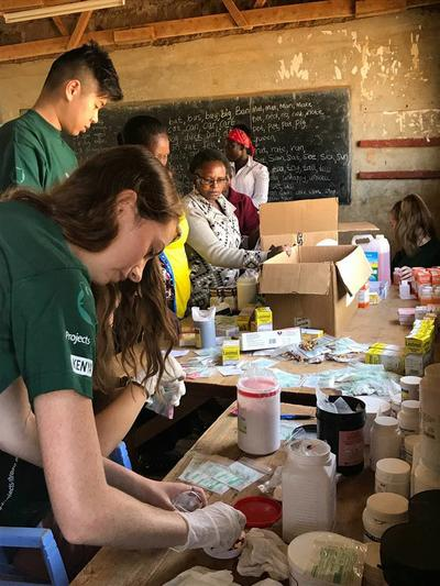 Interns provide healthcare on a medical outreach during their volunteer mission in Kenya