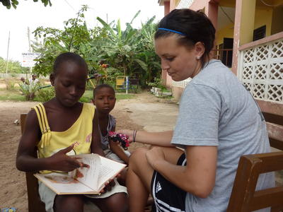 A child in Ghana during a session with a professional social work volunteer