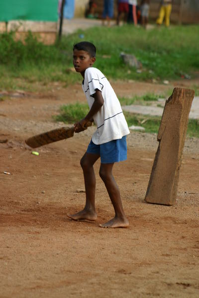 Coach sports like cricket on a Teach Physical Education volunteer placement in Sri Lanka