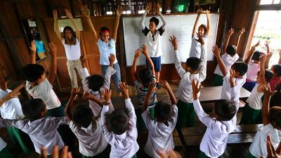 Schoolchildren in Myanmar enjoy a classroom activity led by High School Students on an International Volunteering Opportunity.