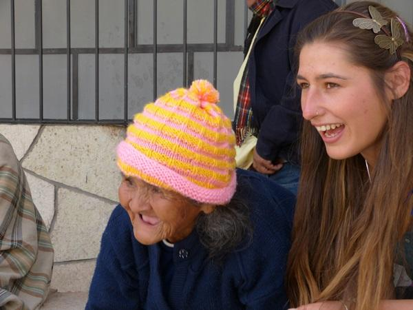 A female volunteers spends time with a resident at a home for the elderly in Peru