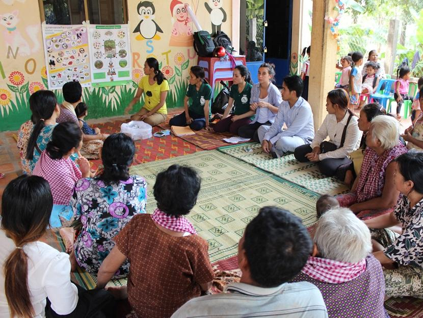 A group of Microfinance interns run a training session for local participants at the project in Phnom Penh, Cambodia