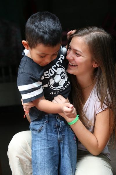 Female volunteer with a child in a care placement in Costa Rica
