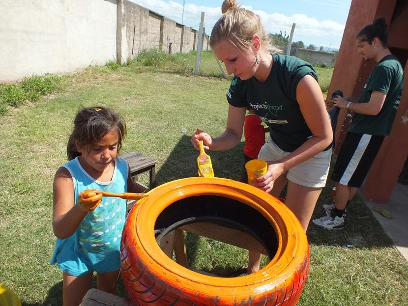 A Projects Abroad Care volunteer participates in a painting activity at her placement