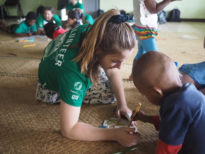 A Projects Abroad volunteer teaches a child arts & crafts at a care center in Fiji