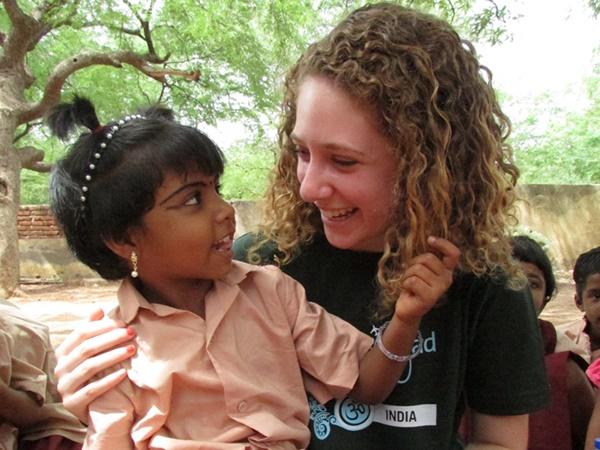 A Projects Abroad volunteer spends time with a child at a Care placement in India.