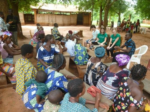 Human Rights interns in Togo lead an educational workshop in a small village