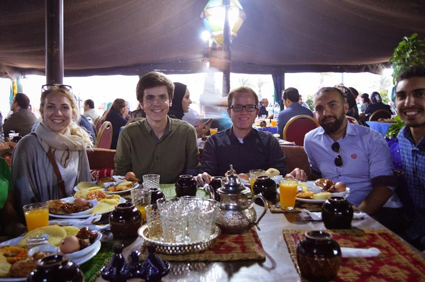 Canadian and British Projects Abroad volunteers and staff members in Morocco enjoy an evening meal in a resturarant together during Ramadan